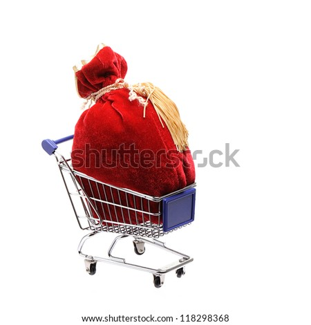 Red Sack full with Christmas gifts in a shopping cart