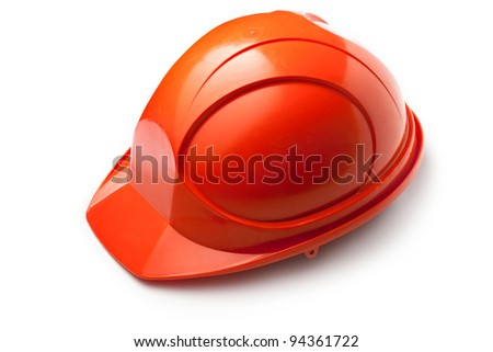 Red safety helmet on white