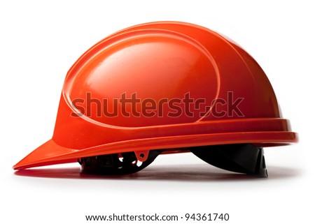 Red safety helmet on white