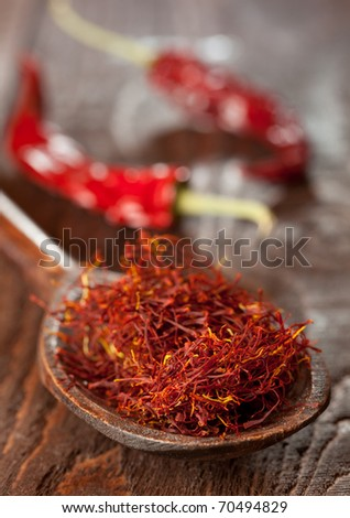 red saffron on wooden spoon closeup