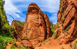 Red sand rock in a mountain canyon. Canyon red sand rock view. Red sand rock in canyon. Kyrgyzstan Grand Canyon