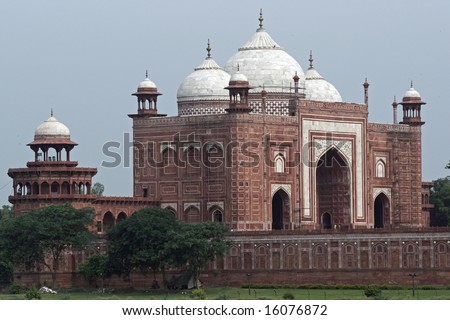 Red sandstone building (Jawab) with white marble domes. Built to provide symmetry by balancing the mosque on the other side of the Taj Mahal (not visible). Agra, Uttar Pradesh. India - stock photo