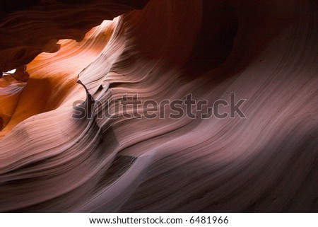 Red sandstone cave-like canyons made with water erosion