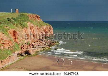 Red sandstone cliffs and a sandy beach in Exmouth, Devon (England)