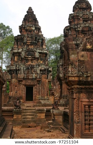 Red sandstone is carved magnificently by ancient Khmer artists at one of the numerous temples of the Angkor complex in Cambodia