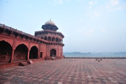 Red sandstone platform next to Yamuna River at Taj Mahal Complex in Agra, India.