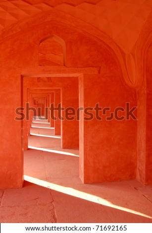Red sandstone reflects the sunlight near the Taj Mahal in Agra, India
