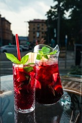 red sangria in a jug and a glass on the cafe table, Still life of traditional Spanish wine beverage sangria
