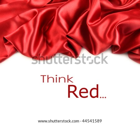Red satin fabric against white background