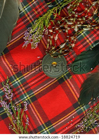 Red scottish plaid with plume, heather and old medallion.