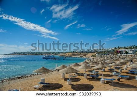 red sea egypt beach sunshade blue sky green water nice view #532039990