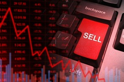 Red sell button on keyboard. Concept - falling selling business. Decrease in sales led to a drop in shipments. Graph down on dark background. Graph down as symbol of falling profits selling business