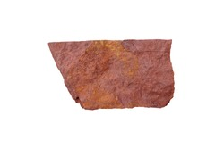 Red shale stone isolated on white background. Shale is a sedimentary rock composed of very fine clay particles.