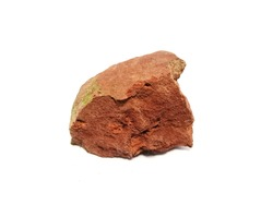 Red shale stone on a white background. There is noise and grain caused by the texture of stone. There are mud elements that contain mineral ores with mineral debris. Especially Quartz and Calcite.