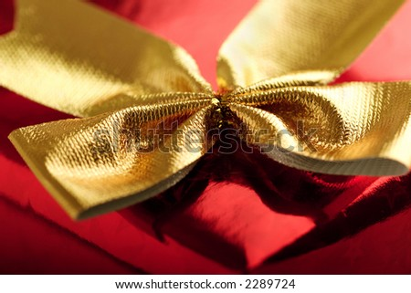 red shiny gift with gold ribbon