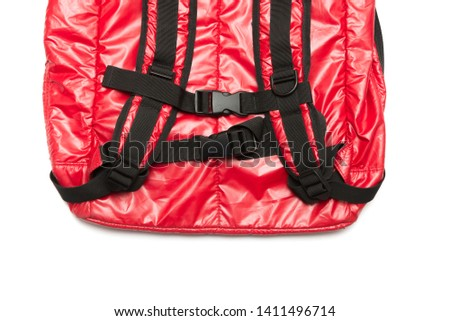 Red shiny nylon backpack isolated on white background. #1411496714