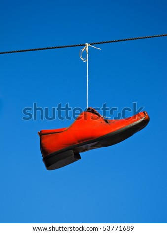 Red shoe against a blue sky.