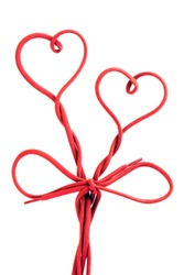 red shoe lace in a shape of two hearts
