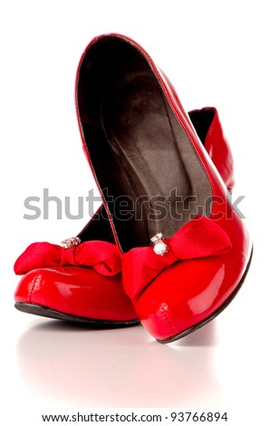 Red shoes isolated on white reflective background.
