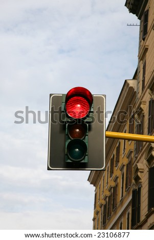 Red signal of traffic-light on the city crossing