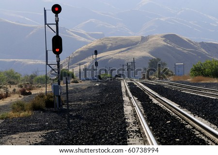 Red signals command trains to stop further forward progress
