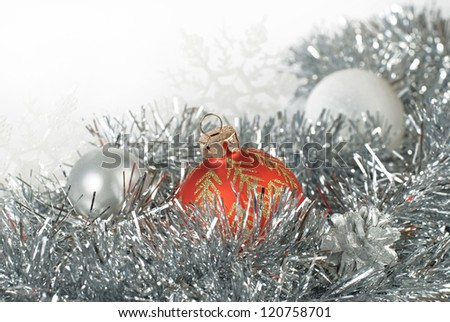 red, silver and blanch christmas balls and a pair of snowflakes on silver tinsel