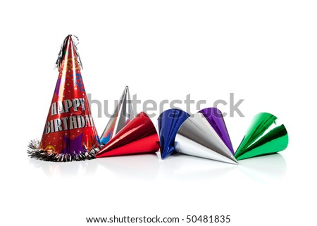 Red, silver, green and blue party hats on a white background