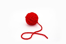 Red skein of thread against white background. Red ball of wool red thread isolated on white