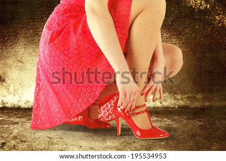 red skirt red shoes and woman