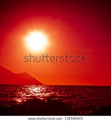 stock-photo-red-sky-and-sun-with-reflection-in-the-sea-138580691.jpg