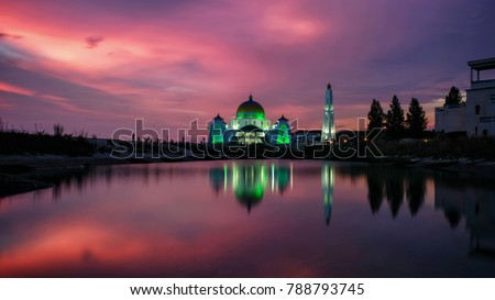 Red Sky during sunset early 2018 at The Magnificent Strait Mosque of Malacca, Malaysia with mirror reflection. #788793745
