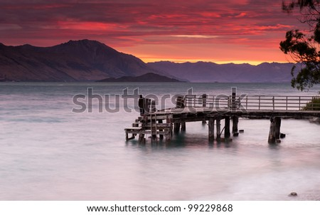 Red sky with wooden pier