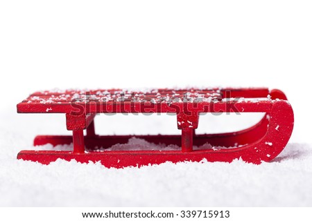 Red sled with snow isolated on white background ストックフォト ©