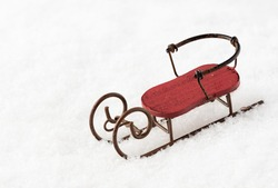 Red sledge in the snow