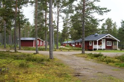 Red small cottages to rent in a holiday park