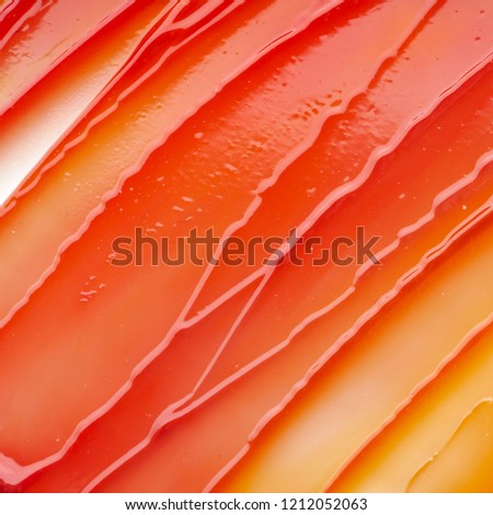 Red smear and texture of lip gloss or acrylic paint isolated on white background Foto d'archivio ©