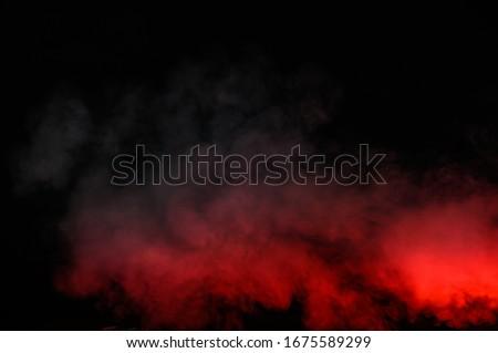 Red smoke isolated on black background stock photo