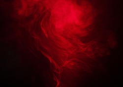 Red smoke over black studio background