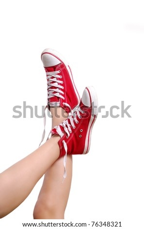 Red Sneakers on beautiful legs