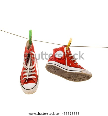 Red sneakers on wire with clothes pin