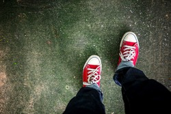 Red Sneakers shoes walking on concrete look top view , Canvas shoes on dirty concrete , Hister life