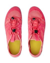 Red sneakers white background isolated close up top view, pink sport sneaker shoes, pair of running gumshoes, two fabric and leather fitness boots, athletic footwear, fashion walking textile footgear