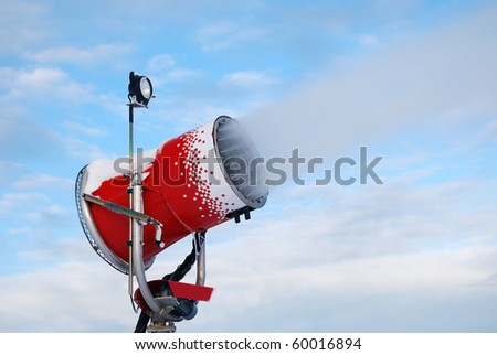 red snow cannon running under blue sky