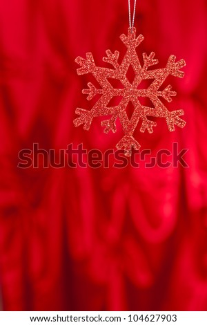 Red snow flake on a red background for Christmas