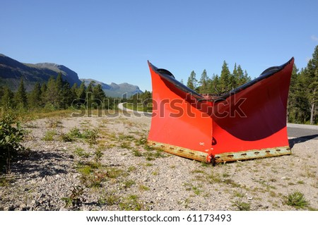 Red snowplow left behind for the next winter. the road leading up to, Ritsem, in northern Sweden.