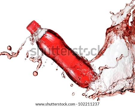 Red soda water bottle splash - stock photo