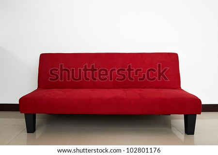 Red sofa in empty living room #102801176