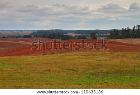 Red soil fields plowed for sowing of winter crops