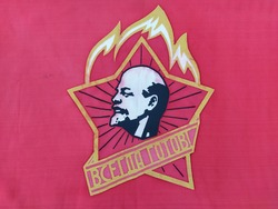 Red soviet flag with the image of Lenin and inscription in Russian
