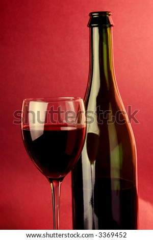 red  sparkling wine glass and bottle